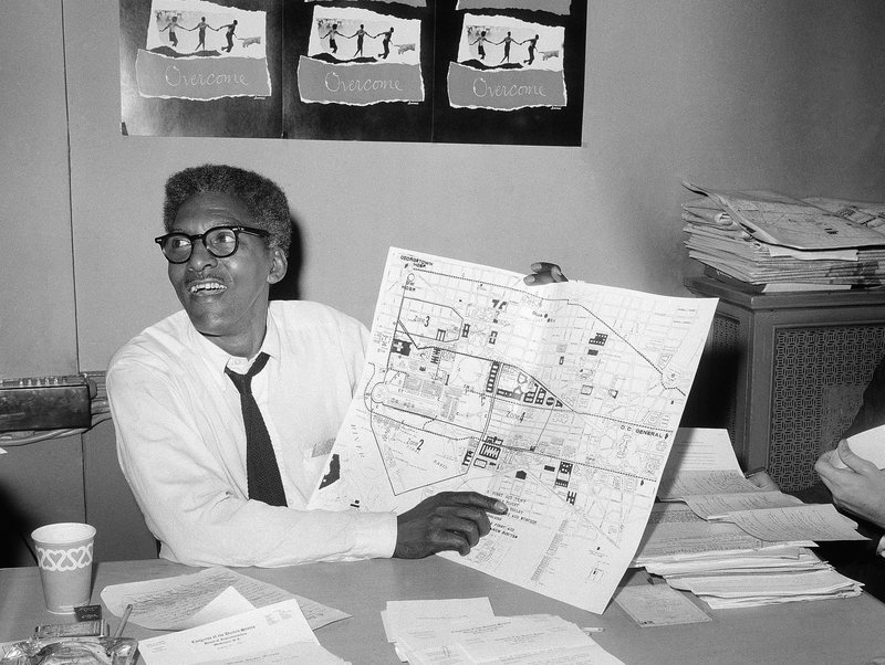 Bayard Rustin points a map during a press conference four days ahead of the March on Washington in August 1963. Photo by the Associated Press.