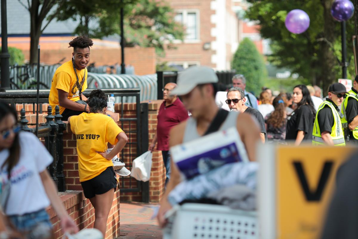 Students, family members and volunteers outside Rhoades Hall during freshman move-in on Saturday.