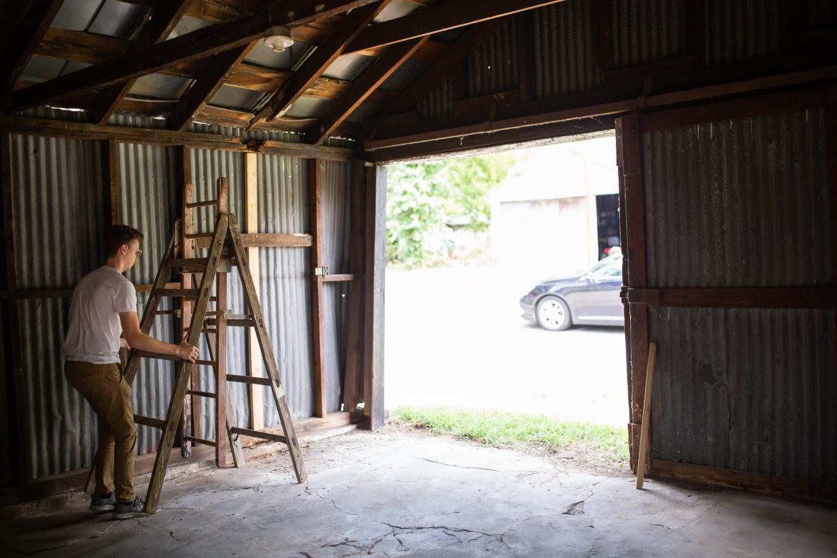 Friends helped Noah Hook and Kim Peters clean out the old backyard shed when they moved to the house in July. Photo by Jon Mirador