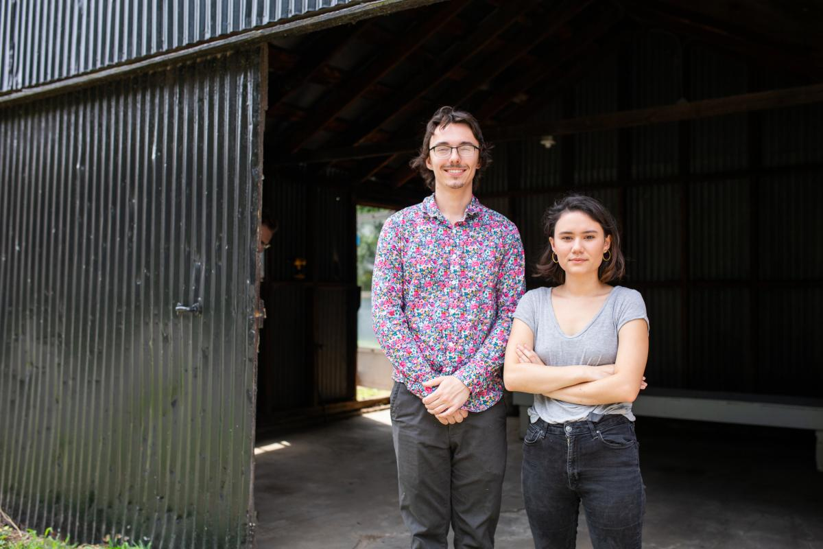 Noah Hook and Kim Peters stand in their backyard outside the shed that will soon become the Rump Gallery. Photo by Jon Mirador